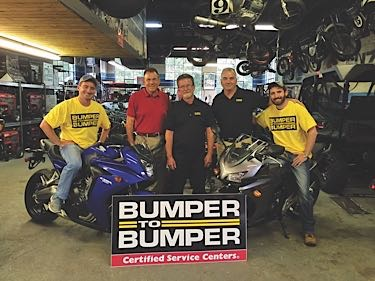 Pictured are recent promotion winners Gary Wyllie, owner of C & G Automotive, and his two sons CJ and Nick; Michael Borr, president of Norwood Motor Parts, and John Tully, sales manager from Norwood Motor Parts.